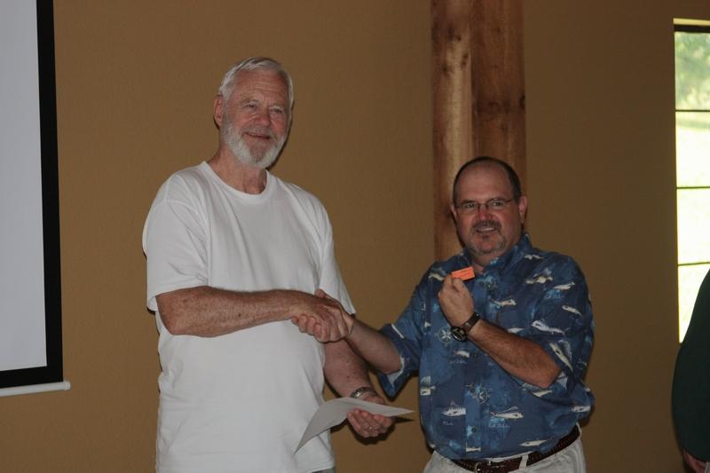 Jim Fisher presenting IDA Door Prize