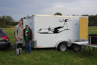 Lt. Col. Bill Engberg and Lora Grosvold pose in front of Bill's equipment trailer. Check out the graphics on the trailer! Bill pilots the huge C-130 Hercules aircraft for the Air Force at Little Rock AFB.